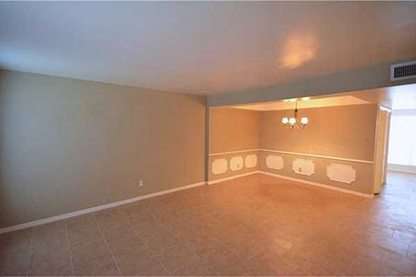 Photo #3 Open door you see this airy living/dining combo. New tiles installed through out the 1st floor.