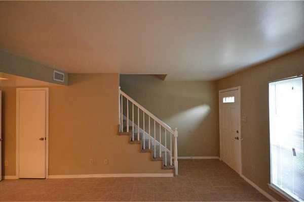 Photo #5 Door on the left opens to spacious storage under stairs.