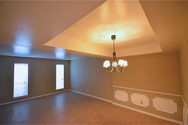 Photo #7 Another view of dining room towards living room.