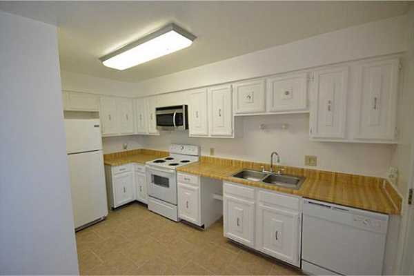 Photo #9 Kitchen in the back of the home