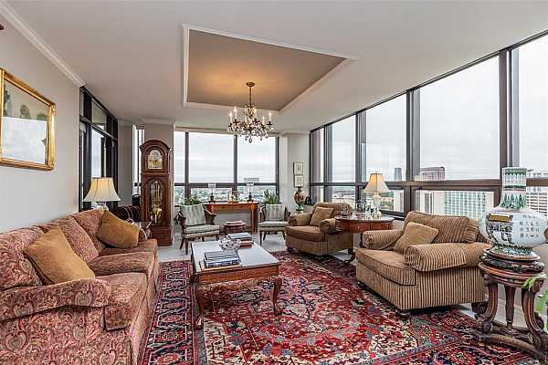 Photo #4 Spacious living area with beautiful north and west views; dynamic skyline and peaceful sunsets.