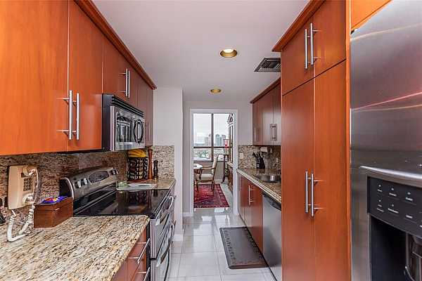 Photo #10 Updated kitchen with stainless steel appliances, immediately adjacent to dining area.