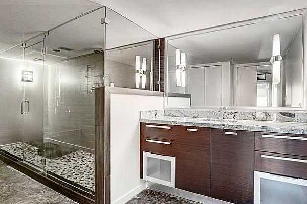 Photo #11 The master bathroom is luxury to the max!