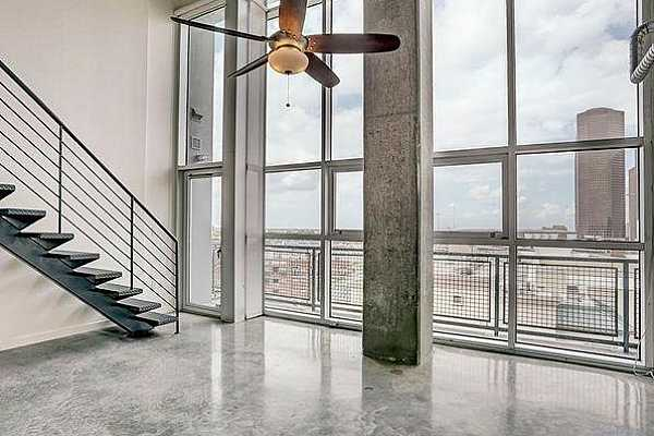 Photo #5 The large windows look out over a beautiful view of the city with full size blinds that are remote activated!