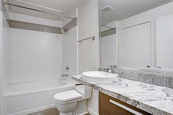 Photo #10 The downstairs bathroom offers plenty of counter space!