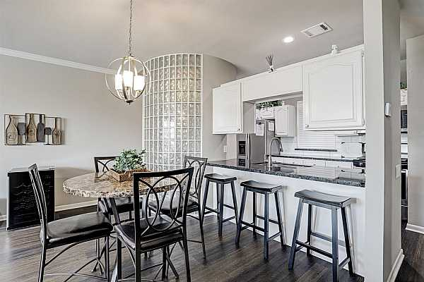 Photo #8 Mix and mingle from kitchen to living/dinning areas.  Great for personal use, family, and social events.
