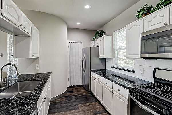 Photo #9 Tasteful and elegant kitchen.  Perfect colored granite and good cabinetry throughout.