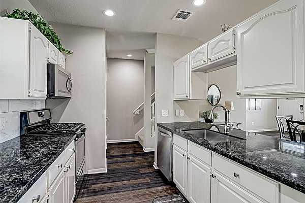 Photo #10 Wide kitchen, great family/dinning room views.  Complimented by elegant hardware, flooring and countertops.