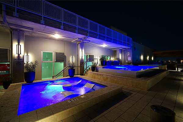 Photo #9 Can you picture yourself relaxing in this beautiful roof-top pool area?