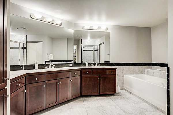 Photo #8 Master bathroom with Marble countertop and Marble tile floors.