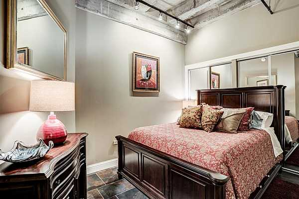 Photo #10 Guest bedroom with open ceiling and slate floor.