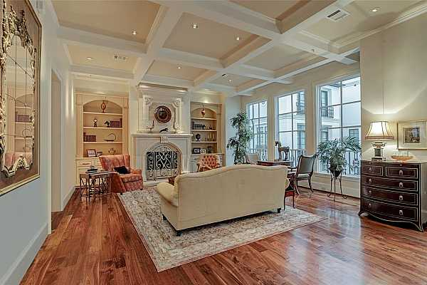 Photo #11 A wonderfully spacious and light filled Living Room accented with a custom stone mantel carved in Mexico and a custom iron fireplace grate.