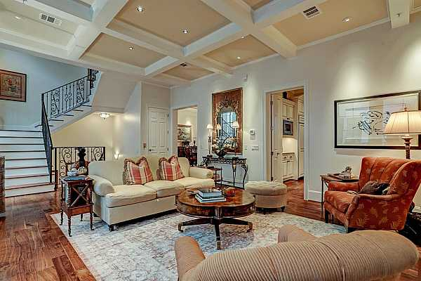 Photo #3 The expansive Living Room with gleaming hardwood floors, coffered ceilings and art lighting is ideal for entertaining with easy flow to the Dining Room and Kitchen.