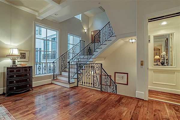 Photo #10 The impressive open staircase emphasizes the overall openness of the floorplan. Or take the private elevator which is centrally located for easy access to all floors.