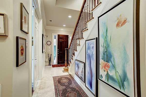 Photo #5 The FOYER has a high ceiling, travertine flooring, recessed lighting, and expanses of wall space for displaying favorite pieces of art.