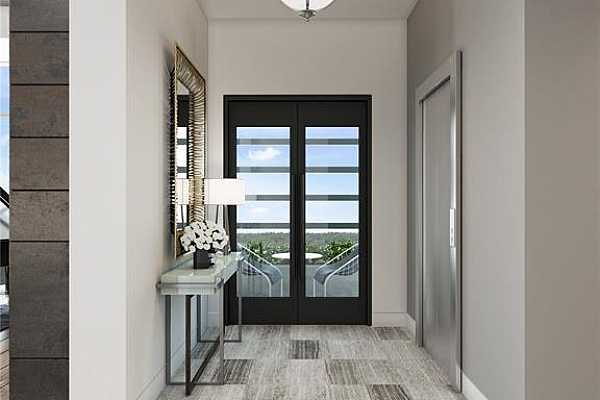 Photo #6 Foyer of a residence with direct elevator access to right and view through door to one of the home