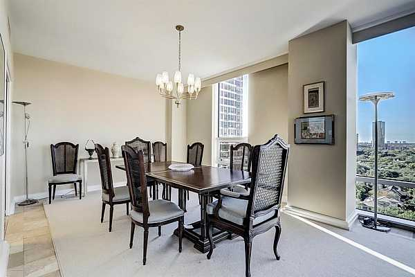 Photo #4 The Dining Room has space for  a table with at least 8 chairs.