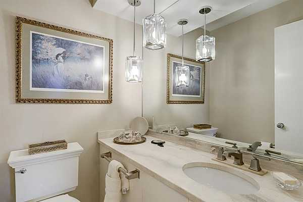 Photo #9 The Powder Room, just off of the entry.