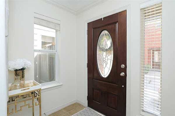 Photo #4 Seeking high levels of comfort and accommodation? This stunning home combines functionality with dazzling form, evident the moment you step through the leaded glass front door and into the light-filled formal entry.
