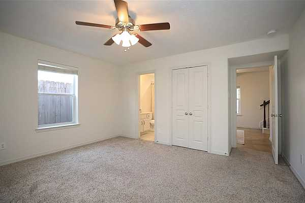 Photo #7 Bedroom on first floor. This home