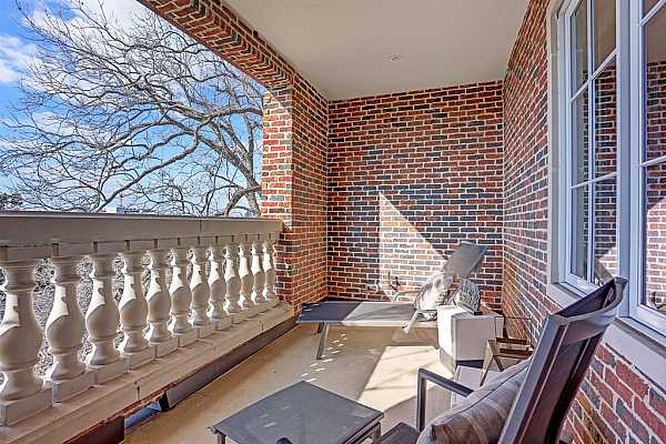Photo #4 Living, dining and kitchen as seen from fireplace. Exceptional room proportions and architectural design allow for easy entertaining of large and small groups. (This chandelier is excluded by seller)