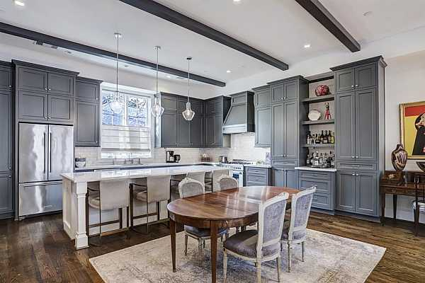 Photo #6 Panning around primary bedroom shows scale of space. Lots of options how you can arrange / furnish. Plantation shutters, elegant finishes complete this room. (Curtains are excluded by seller)