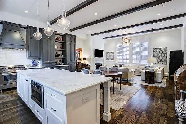 Photo #10 Built in bar area seamlessly bridges the space from kitchen to dining to living.