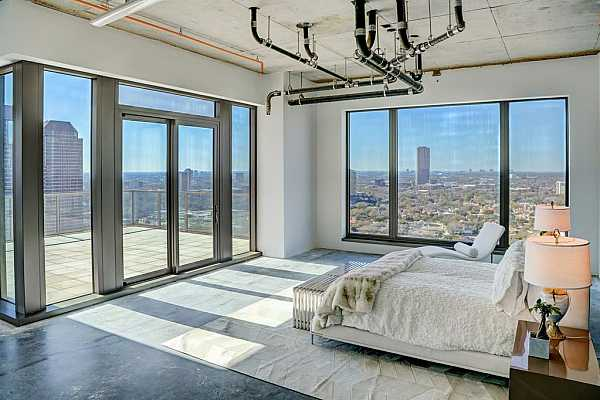 Photo #5 This gorgeous home features 270 degree view of Houston showcased in expansive windows throughout.