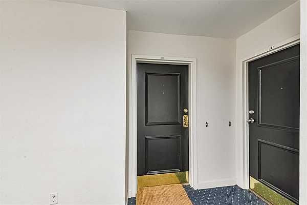 Photo #3 Unit 123 is to the right once you exit the stairs or straight ahead if you exit the elevator.