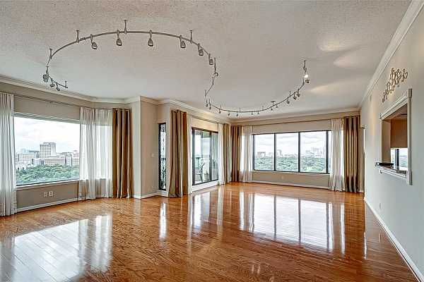 Photo #1 Spacious living room and dinning room with wood floors and a spectacular view.