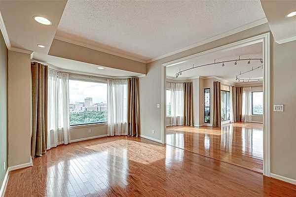 Photo #5 Family room, convertible to a third bedroom, if desired. Gorgeous views throughout the whole house.
