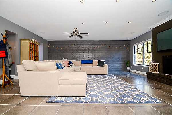 Photo #4 BIG living area with gorgeous exposed brick wall