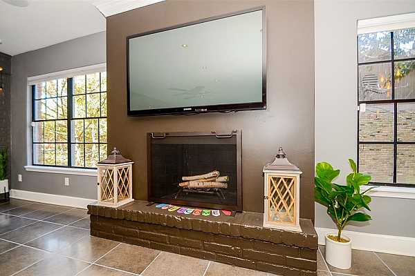 Photo #8 Such a pretty fireplace...PERFECT for the TV! And great windows letting in that awesome natural light!