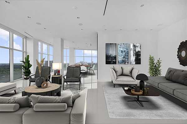 Photo #5 The same view. Clean white flooring will make for a spectacular contemporary setting! The open kitchen is just behind the half wall. You can see downtown on the horizon.