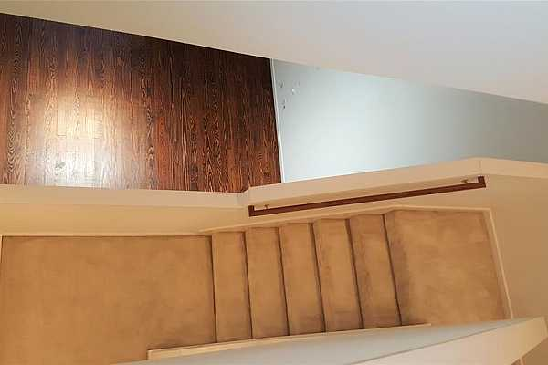 Photo #10 The stairs start with easy clean wood at the ground level, then transition to quiet, comfortable carpet as the stories progress.