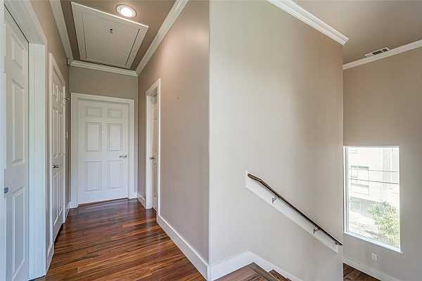 Photo #11 Stylish stairwell leading to all floors is open and naturally bright. refinished flooring sparkles.