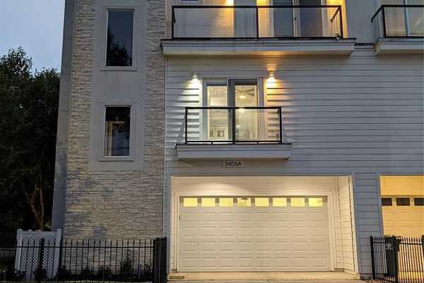 Photo #3 Welcome home to 3406 Honsinger Street. This gorgeous 3-level town home boasts an expansive open concept, featuring a designer kitchen with informal dining that opens to your living room. Open concept design with massive primary bedroom. Private corner with gorgeous views in every room.