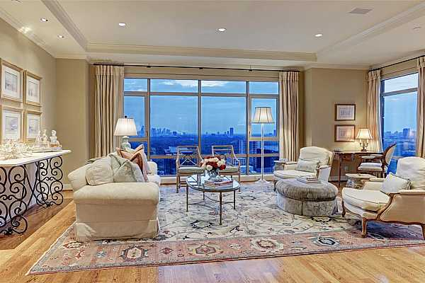 Photo #6 The Living Room affords not only an eastern view of the city below - but also a southern view. A well planned seating arrangement also allows for a writing desk in the room