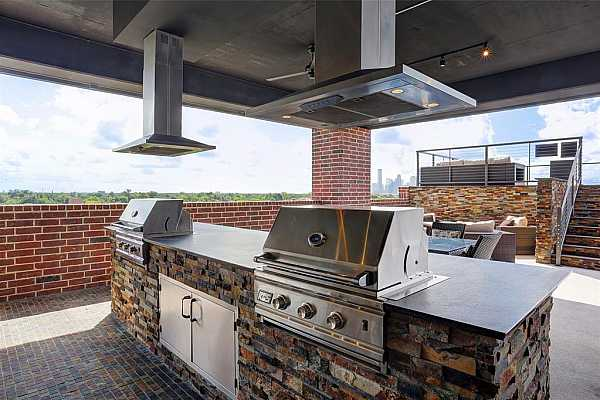 Photo #11 Amenities include fabulous roof deck space open to all owners with cooking/serving area like this at previous Heights development by builder at 1111 Studewood-Schedule a tour today and you just might get drinks & food at The Cantina!