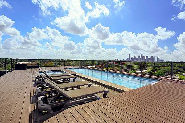 Photo #5 All owners enjoy the downtown Southern views from the rooftop deck, pool and serving area. Photo of previous Heights development by builder at 1111 Studewood-Schedule a tour today and you just might get drinks & food at The Cantina!