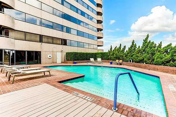 Photo #12 Primary bedroom with floor to ceiling window and sliding door to terrace. Two walk-in closets.  Concrete floors. Virtually staged.