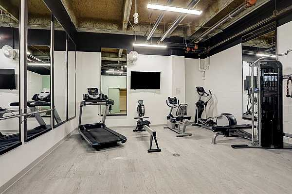 Photo #9 The light filled kitchen opens to the breakfast area. Bosch dishwasher.  Fisher & Paykel refrigerator.  LG oven and microwave.  Granite counters and backsplash.