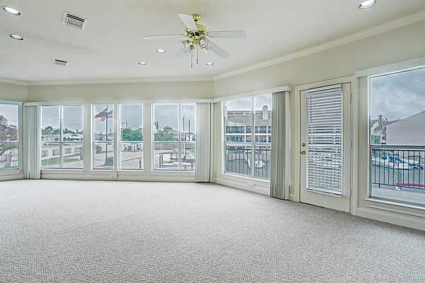 Photo #3 Gorgeous Wall of Windows in your Living Space that look out over the water and NASA 1