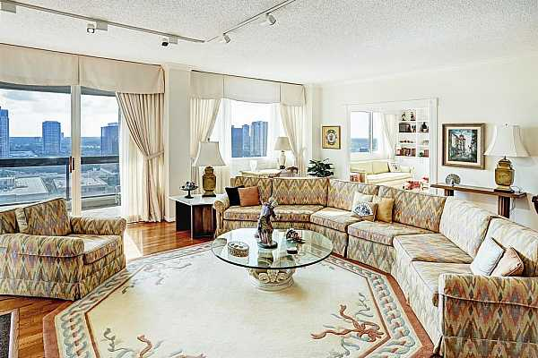 Photo #5 Large living room with hardwood floors perfect for entertaining.  The adjoining study gives you even more room for guests.  Unbelievable views from this light filled unit.