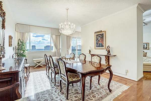Photo #7 This exquisite dining room is perfect for dinner parties and family gatherings.   Hardwood floors, crown molding and fabulous views of the Galleria.
