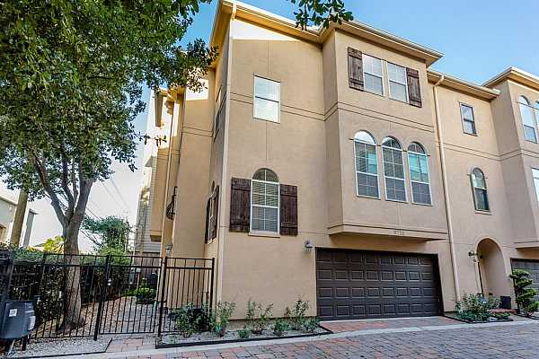 Photo #1 Welcome to 5715 Kansas Street in the highly desirable Cottage Grove subdivision with a gated entrance! This 2,352 SQ FT stucco 3-story townhome has 3 beds & 3.5 baths with its own private gated front yard (30x10)!