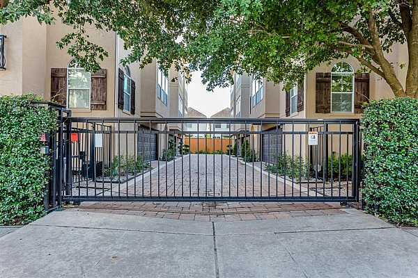 Photo #4 Private, gated resident entry.