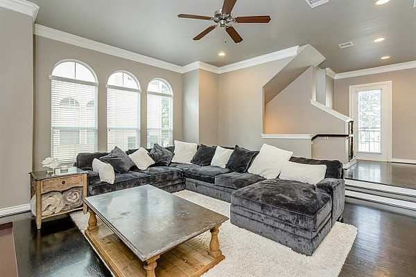Photo #8 The Family Room is the perfect space for entertaining. With an abundance of natural light, gorgeous hardwood floors, and a wall of windows for abundant natural light.