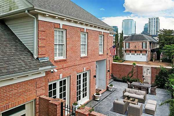 Photo #9 The formal entry features a paneled staircase. This space is flanked by the office (secondary bedroom) and a formal living room.