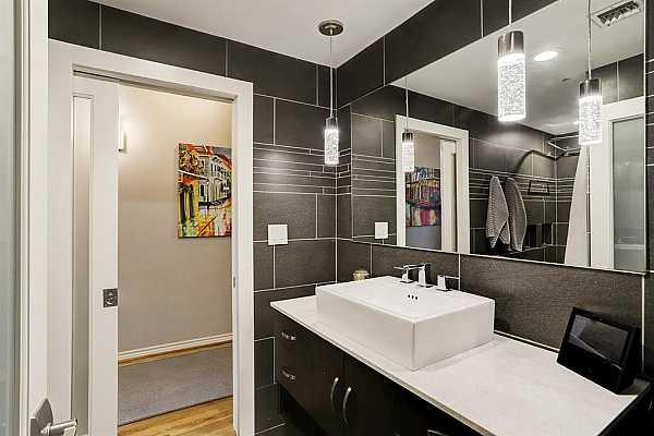 Photo #11 The thoroughly gut renovated bathroom is accessible from both the hall and owner
